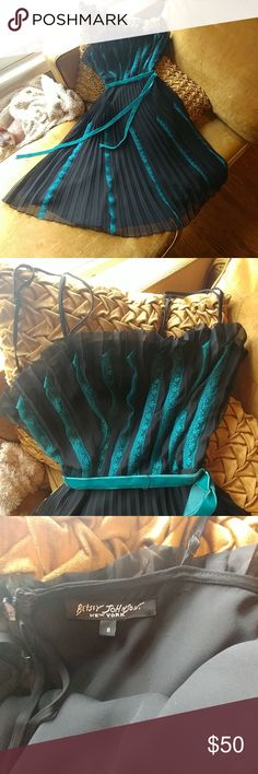 """Betsey Johnson Black and Teal Dress Pre-bankruptcy Betsey Johnson teal and black dress size 8. Bust 16"""" waist 14"""" with a little stretch. Worn once. EUC. A tiny bit if fraying that I think could be trimmed. Pictured. Betsey Johnson Dresses Midi"""