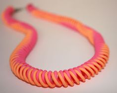 Viral Spiral necklace by Carole Monahan - made with Makin's Clay® no bake, air dry polymer clay and the Ultimate Clay Extruder™ - http://www.makinsclayblog.blogspot.com/2015/06/viral-spiral-necklace-by-carole-monahan.html