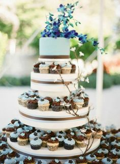 blue and chocolate wedding cakes for cupcake with flower topper