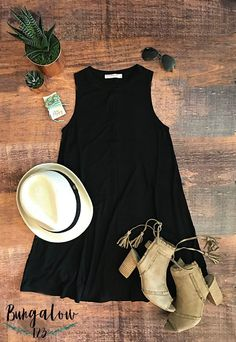 Summer sleeveless black swing dress with a straw hat & ankle boots.