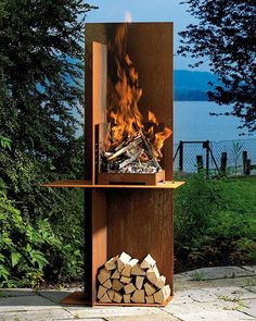 Garden fireplace from Attika... If you like simple straight lines of this Conmoto fireplace, the open design of the massive Attika EOS may appeal to you as well. Measuring 190cm in height, EOS garden fireplace is designed from heavy 5mm thick interleaved steel plates, with the horizontal plate that not only supports the fire but also functions as a screened work and storage surface. You can also set the large stainless steel grill at 4 different levels. ... #BBQ #Grills #Smokers #Firepits