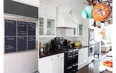 Another white oven hood with white cabinetry. Kitchen Ideas from our Favorite Designer Homes