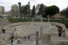 """Roman Amphitheatre of Kom el-Dikka  Kom el-Dikka, which literally means a """"pile of rubble,"""" was a slum until 1959 when a team of Poles excavated the site in search of the tomb of Alexander the Great. With 800 marble seats, graffiti of chariot team supporters, and two forecourts with mosaic flooring, the discovery was not a disappointment."""
