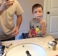Father and son bond through shaving.