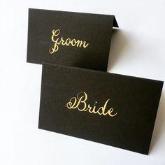 Stylish gold ink on black place cards