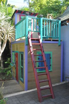Favorite club-house. Door, windows, second story. Ship wheel on the top. Ladder to the top. Looks like it's in a small patio space. Safe (railing on second floor to prevent falls).