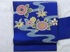 This is a Shioze Nagoya obi with flowing water and kiku(chrysanthemum) design, which are dyed with Katazome(stencil-dyed) technique