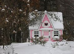Snow-covered, pink fairy cottage