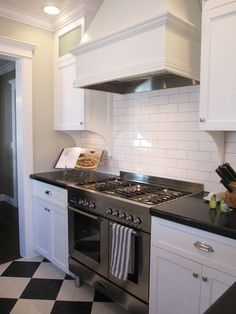 Black and White Linoleum floor....subway tile kitchen idea
