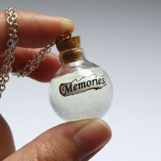 "Could do this like ""Hippy Swirls"". Memories in a Glass Vial Bottle Necklace. Harry Potter, Snape, Dumbledor, Potion"