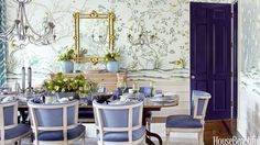 The deep color of the door in this dining room complements the glamorous decor scheme.