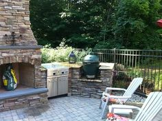 pictures of green egg built in patio by fireplace   Grand Rapids Fireplace, Outdoor Kitchen, and Pool traditional-patio