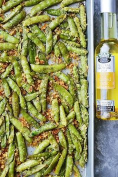 Garlic Parmesan Sugar Snap Peas - Healthy, delicious and quick to make roasted sugar snap peas tossed in a crunchy and flavorful parmesan cheese mixture. *note- replace panko bread crumbs with gf crumbs Pea Recipes, Vegetable Recipes, Summer Recipes, Cooking Recipes, Vegetarian Recipes, Healthy Recipes, Skinny Recipes, Fruit Recipes, Cooking Tips