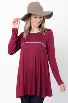 Burgundy Lace Trim Tunic  http://www.caralase.com/lace-trim-tunic/  Long sleeve jersey top with a lace trim by Caralase. Cut in a relaxed + swingy silhouette, finished with a plenty long hem and lace trimming.  #Lacetrimtunic #trimtunic #lacetunic #tunics #tunicsforwomen #longsleevejerseytop #jerseytop #tops #longsleeve #burgundy #black #charcoal #olive #navyblue #navy #cool #caralase #fashion #newarrivals #cute #best #latest #womens #ladies #girls #ootd #trendy #lifestyle #cheap
