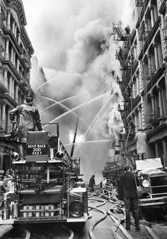 """livelymorgue:  Feb. 21, 1957: Powerful streams are concentrated on the fire in structure between Broome and Spring Streets, read the published caption on a photo of a Manhattan fire. The five-story brick building contained large quantities of baled textile remnants. Photo: Neal Boenzi/The New York Times   """