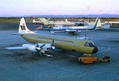 Braniff International Airlines Lockheed Electra at Denver Stapleton Airport with that Eastern Airlines Electra...