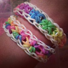 Rainbow loom braclets. White perimeter bands. Rainbow starburst pattern!