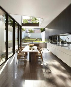Beautiful kitchen with an amazing amount of natural light. .  .  .  .  .  #kitchen #architecture #design #homeimprovement #home #homedecor #dreamhome #remodel #homerenovation #interiordesign #decor #cabinets #natural #lighting #dreamkitchen #kitchengoals #house #relax #glasshouse #soothing #naturallight #kitchendesign #nature #garden #openhouse #sleek #modern