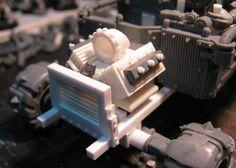 a close up of a scratch built engine.