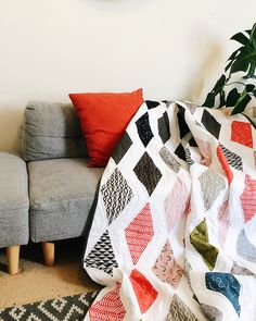 Modern geometric quilt made from Arroyo fabric - patterned linen quilting fabric in beautiful geometric designs.