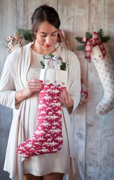 Tone Finnanger with her Tilda Cozy Christmas Stocking with scalloped edge.