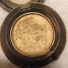 MAC Cosmetics Makeup - MAC WOODWINKED . Woodwinked is beautiful. It is not even close to this gold though. Darker and browned.