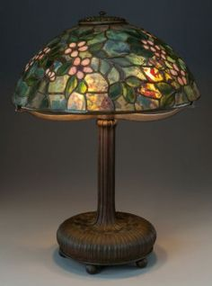 TIFFANY STUDIOS LEADED GLASS AND BRONZE APPLE BL