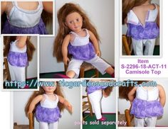 This Camisole style Shirt / Top for your 18 inch / American Girl Style Doll is handmade using a mix of pale and dark purples. This top, with a light lavender cotton outer shell and lavender jersey knit inner lining; secures at the back, with purple hook & loop tape that is secured with purple and white thread. Dark purple stitching adorns the outer edge of the top, and the jersey knit lavender straps as well. The same dark purple thread creates a waistband appearance to top where the low...