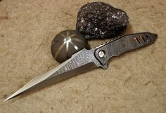 Damascus on Damascus Dagger by   Olexander Bogdanovich.  High constrast damascus blade with hand sharpened edges, copper liner, damascus scales, full tang. 5.25 inch blade, 9.5 inches overall.
