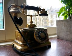 An old gold telephone
