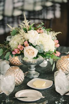 Floral centerpiece in silver urn. Photography: Weber Photography- Cory Weber - weber-photography.com