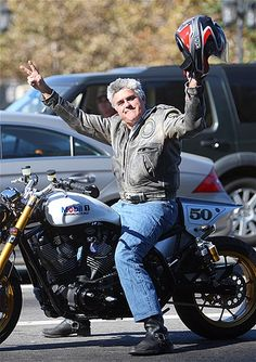 Jay Leno is famous for collecting motor vehicles. Here he sits on one of his 90 or so motorcycles.