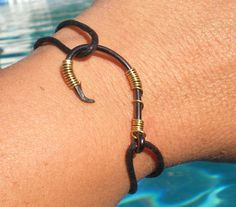 Fishing can be a great stress reliever. Find out more about fishing as a stress relieve, including tips on catching fish and staying safe. Fish Hook Bracelet, Fish Hook Jewelry, Wire Jewelry, Jewelry Crafts, Jewelry Ideas, Fisher, Ankle Chain, Fish Crafts, Country Jewelry