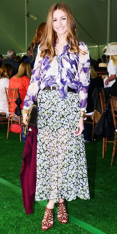 Olivia Palermo in a mixed print ensemble, gold bracelet, chainstrap bag and strappy sandals.