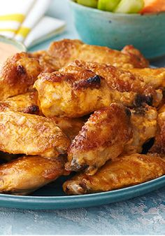 Hot & Spicy BBQ Wings – Here are chicken wings just the way your big and little fans like them—a little garlicky, with spicy-hot sauce, and a sprinkle of sliced green onion. This flavorful appetizer would be great for game day.