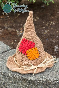 Keep the crows away from your corn this fall with this crochet scarecrow hat! Adorned with mock patches and a raffia trim, you are sure to be