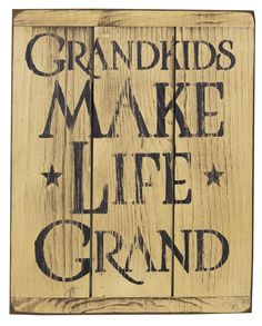 "The text ""Grandkids Make Life Grand"" on a cream background. This sign is made from rustic painted wood slats for a beautiful primitive look. A keyhole is in the back for easy hanging. The sign is 13 1"