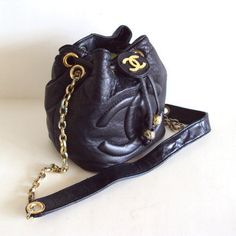 vintage leather x drawstring purse :: #Chanel