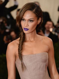 joan smalls with a purple lip at the 2014 met gala