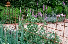 Traditional, handmade garden plant supports, including arches, obelisks, peony supports & more - explore our inspiring range & order today! Peony Support, Garden Plant Supports, Raspberry Canes, Fruit Cage, Fruits And Vegetables, Garden Plants, Peonies, Home And Garden, Gardening
