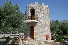 Check out this awesome listing on Airbnb: Tower House over beach + 2 bikes in Fragkokastello