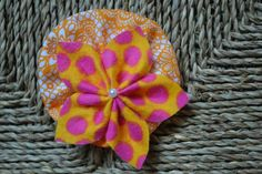 Hot pink and Orange pokla-dot fabric petal flower with pearl accent set on orange and white floral ruffle - hair clip - hair accessories