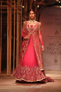 Nethra Raghuraman takes to the ramp to display another bridal collection in a deep red at the Amby Valley India Bridal Fashion Week 2013 Day 1. #Fashion #Style #Beauty