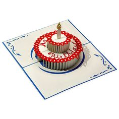A surprising pop up cake inside of a beautiful blue birthday card. Complete with icing and a candle. Happy Birthday!