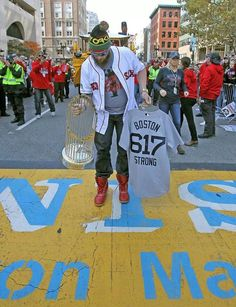 Johnny Gomes placing the trophy on the Boston Marathon finish line