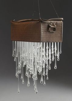 """Rain box"" by Karen Cunningham.  Rain Box 2014 by Karen Cunningham. Hot sculpted glass, cold worked, found metal object."