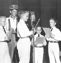 Frank Sinatra rehearsing with the Crosby kids for their appearance on his radio show, 1945