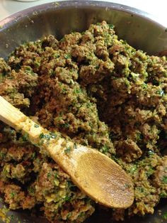 Homemade dog food- grain free- beefy pumpkin & greens mash up- 5 lbs 80/20 ground beef cooked & drained, 1 29 oz can pumpkin purée, 1-2 cups fresh parsley finely chopped, 1-2 cups fresh kale finely chopped, 1 cup olive oil, 1 cup flax meal, several apples (especially the older ones no one wants) cored and finely chopped- I use my food processor ;)- mix and store in containers in fridge or freezer - this recipe feeds my dogs totaling 35lbs for 5 days:
