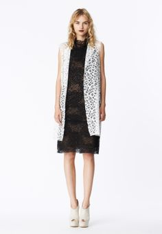 LOOK 16 White honeycomb lace sleeveless coat.  Black spider web lace shift tank dress layered over black primrose Chantilly lace cowl neck sheath.