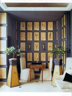 Dozens of antique botanicals collectively displayed in slender black frames placed on aligning walls.